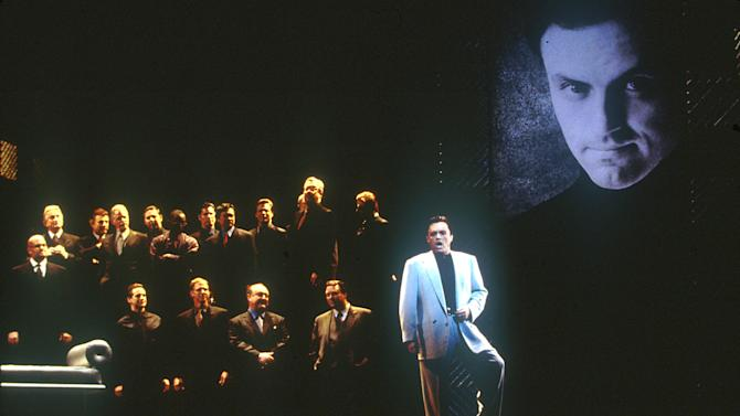 """This March 2000 photo released by the Los Angeles Opera shows tenor Frank Lopardo as Duke, right, performing with the chorus in """"Rigoletto,"""" in Los Angeles. The first of Giuseppe Verdi's three great middle period triumphs has been shifted before to New York's Little Italy, Federico Fellini's Rome, modern-day Hollywood and even the Oval Office. Now it will take place amid dazzling Sin City lights and not in the Renaissance Palazzo Ducale when Michael Mayer's version of the 162-year-old classic opens Monday night.  (AP Photo/Los Angeles Opera, Ken Howard)"""