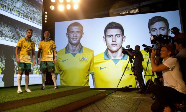 The Australian National Team Kit to be worn by the Socceroos at the 2014 FIFA World Cup is unveiled by players Zullo and Bresciano in Sydney