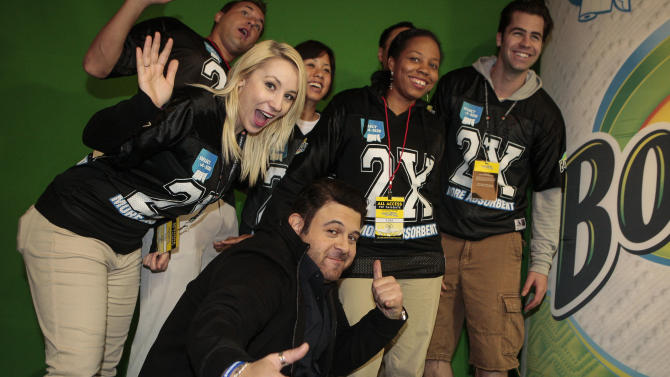 IMAGE DISTRIBUTED FOR BOUNTY - Travel Channel's Adam Richman hangs with football fans at the Bounty-Select-A-Size booth during 2013 Rose Bowl Game VIP Tailgate on Tuesday, Jan. 1, 2013, in Pasadena, Calif. (Bret Hartman/AP Images for Bounty)