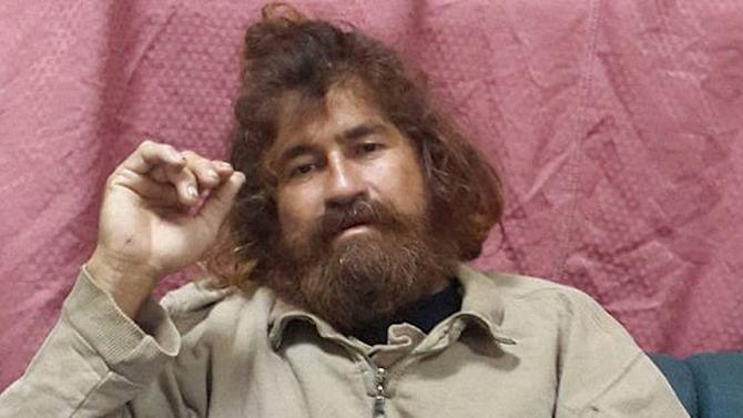 In this Monday, Feb. 3, 2014 photo provided by the Marshall Islands Foreign Affairs Department, a man identifying himself as 37-year-old Jose Salvador Alvarenga sits on a couch in Majuro in the Marshall Islands, after he was rescued from being washed ashore on the tiny atoll of Ebon in the Pacific Ocean. Alvarenga told the U.S. ambassador in the Marshall Islands Tom Armbruster and the nation's officials that he left Mexico in December 2012 for a day of shark fishing and ended up surviving 13 months on fish, birds and turtles before washing ashore on the remote Marshall Islands thousands of miles (kilometers) away. (AP Photo/Foreign Affairs Department The Marshall Islands, Gee Bing)