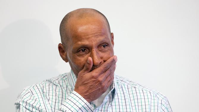 Louis Taylor wipes away tears during a news conference with the legal team from the Arizona Justice Project in downtown Phoenix on Wednesday, April 3, 2013.  Taylor, 58, was released Tuesday after doubts about his conviction surfaced and he entered a no-contest plea in a deal with prosecutors.  Taylor was 16 years old when he was arrested in the Pioneer Fire in Tucson in 1970. Taylor, who is black, was later convicted by an all-white jury and sentenced to life in prison.   The case ended up back in court after a new defense team and others raised fresh questions about the evidence used to convict Taylor. Authorities still insist Taylor is guilty, but they acknowledged that gaining a conviction at a new trial would be dicey given that some evidence has been lost and witnesses have either moved or died.  (AP Photo/The Arizona Republic, Michael Schennum)  MARICOPA COUNTY OUT; MAGS OUT; NO SALES