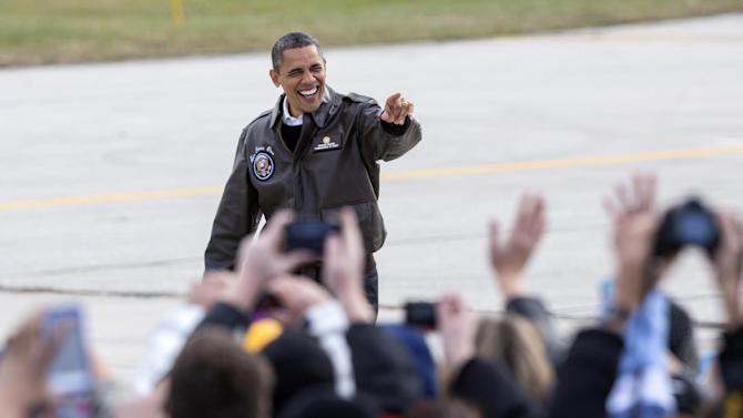 President Barack Obama waves to supporters upon his arrival in Green Bay, Wis., Thursday, Nov. 1, 2012, for a quick campaign stop before heading to Las Vegas. (AP Photo/Tom Lynn)