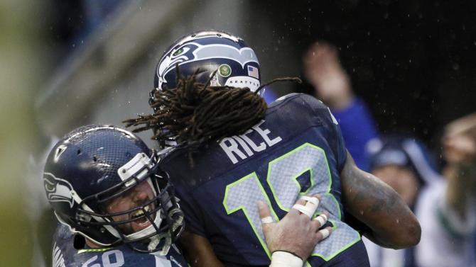 Seattle Seahawks' Sidney Rice (18) celebrates his touchdown with teammate Max Unger (60) during the second half of an NFL football game against the New York Jets, Sunday, Nov. 11, 2012, in Seattle. (AP Photo/Elaine Thompson)