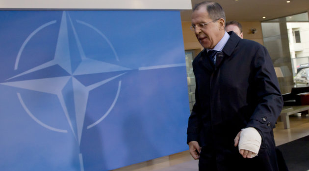 Russian Foreign Minister Sergey Lavrov is seen with a bandaged hand as he arrives for a meeting of NATO foreign ministers at NATO headquarters in Brussels on Tuesday, Dec. 4, 2012. NATO foreign ministers are expected to approve Turkey&#39;s request for Patriot anti-missile systems to bolster its defense against possible strikes from neighboring Syria. (AP Photo/Virginia Mayo)