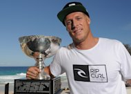 GOLD COAST, AUSTRALIA - DECEMBER 20: 2013 ASP World Champion Mick Fanning poses for a photograph at Rainbow Bay SLSC on December 20, 2013 on the Gold Coast, Australia. (Photo by Matt Roberts/Getty Images)