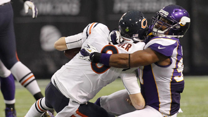 Minnesota Vikings defensive end Everson Griffen, right, sacks Chicago Bears quarterback Jay Cutler during the first half of an NFL football game Sunday, Dec. 9, 2012, in Minneapolis. (AP Photo/Genevieve Ross)