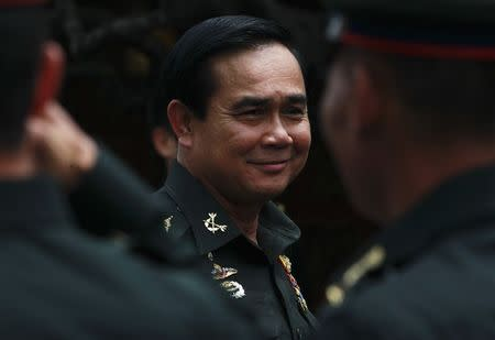 Thailand's newly appointed Prime Minister Chan-ocha smiles during his visit to the 2nd Infantry Battalion, 21st Infantry Regiment, Queen's Guard in Chonburi province