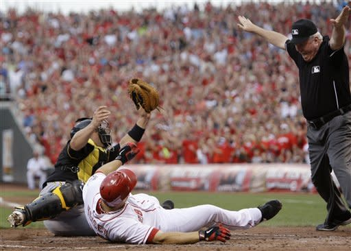 Latos pitches and hits Reds past Pirates 3-0