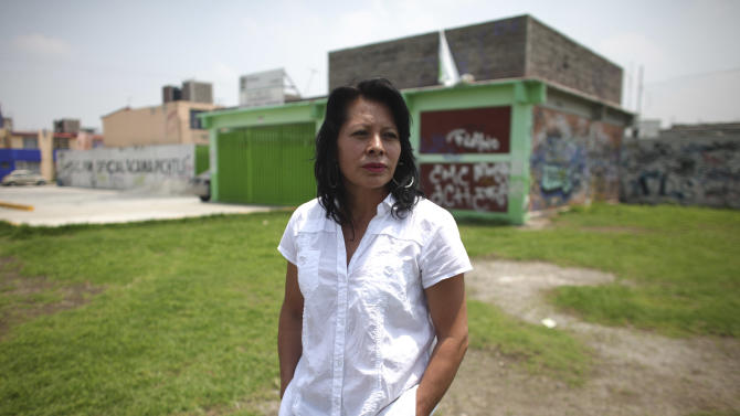 "This July 28, 2011 photo shows Raquel, 44, a teacher who did not want to give her surname, during an interview in Ecatepec, Mexico. Raquel's brother, Leobardo Lopez, a cook at the Windows on the World restaurant on the 107th floor of the World Trade Center, was killed during the Sept. 11, 2001 attacks. Unable to afford visas to the U.S. for the tenth anniversary, they will watch the commemorations on television. ""Where we all want to be that day, though, is ground zero,"" says Lopez, her eyes watering. ""We want to be where he died, with people who are going through the same pain we are going through, and who understand that void we were all left with."" Like many families of foreign victims, Lopez was disturbed by the wars that followed 9/11. This year, the family will wear white as a symbol of their wish for peace. (AP Photo/Alexandre Meneghini)"
