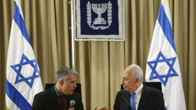 Israel's President Shimon Peres, right, listens as Yair Lapid, leader of the Yesh Atid (There is a Future) party, speaks during their meeting in Jerusalem, Wednesday, Jan. 30, 2013. Israel's two major political parties endorsed Benjamin Netanyahu for prime minister Wednesday, guaranteeing him a third term and kicking off the country's post-election process of forging a new government. The factions recommended Netanyahu to President Shimon Peres, who began consulting representatives from the major parties at his residence before deciding whom to choose as prime minister-designate to form a new coalition. (AP Phoro/Ronen Zvulun, Pool)