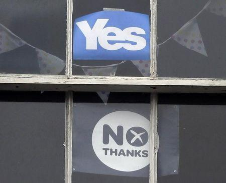 'Yes' and 'No' campaign posters are seen in the window of an apartment in the centre of Edinburgh