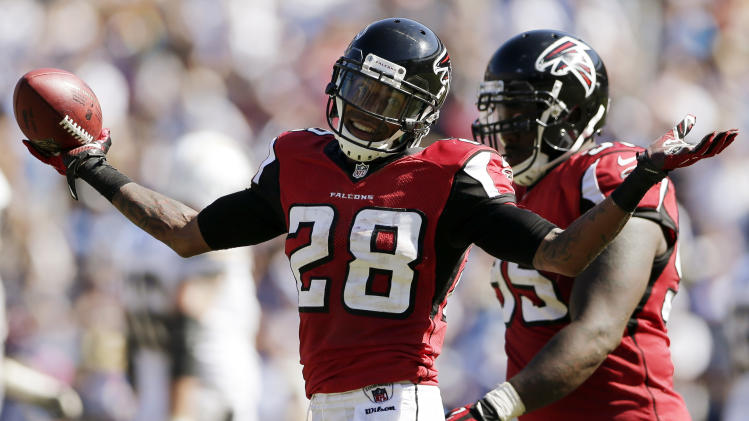 FILE - This Sept. 23, 2012 file photo shows Atlanta Falcons free safety Thomas DeCoud celebrating an interception against the San Diego Chargers during the second half of an NFL football game in San Diego. The Falcons keep coming up with turnovers at just the right time _ no one more so than  DeCoud. (AP Photo/Gregory Bull, File)