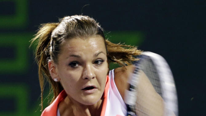 Agnieszka Radwanska, of Poland, returns a shot from Serena Williams during a semifinal match in the Sony Open tennis tournament, Thursday, March 28, 2013, in Key Biscayne, Fla. (AP Photo/Wilfredo Lee)