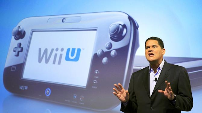 Reggie Fils-Aime, president and chief operating officer of Nintendo of America, discusses the upcoming Wii U gaming console, Thursday, Sept. 13, 2012 in New York. The gaming console will start at $300 and go on sale in the U.S. on Nov. 18, in time for the holidays, the company said Thursday. (AP Photo/Mark Lennihan)