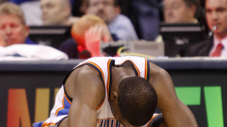 Oklahoma City Thunder's Kevin Durant kneels to the floor in the final seconds of  overtime against the Dallas Mavericks in  Game 4 of the NBA Western Conference finals basketball series Monday, May 23, 2011, in Oklahoma City. The Mavericks won 112-105. (AP Photo/Eric Gay)