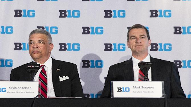 Maryland head basketball coach Mark Turgeon, right, sits with Maryland athletic director Kevin Anderson during a news conference announcing the 2017 Big Ten Conference men's basketball  tournament will be held in Washington, on Tuesday, May 6, 2014, in Washington. Four players have left the Maryland men's basketball program this offseason
