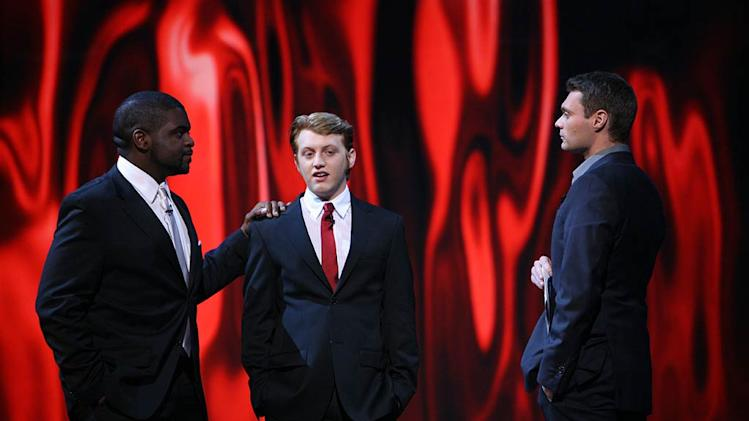 Colton Berry (center) is eliminated from the 7th season of American Idol.