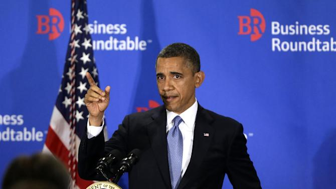 President Barack Obama gestures as he asks if the back of the room could hear him after the podium microphone stopped working while he was speaking about the fiscal cliff during an address before the Business Roundtable, an association of chief executive officers, Wednesday, Dec. 5, 2012, in Washington. (AP Photo/Charles Dharapak)
