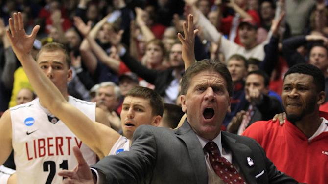 Liberty head coach Dale Layer reacts in the closing minute of their 73-72 loss to North Carolina A&T in a first round NCAA college basketball tournament game, Tuesday, March 19, 2013, in Dayton, Ohio. (AP Photo/Skip Peterson)