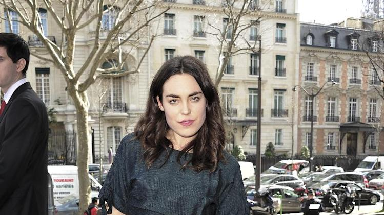 Tallulah Harlech arrives at Miu Miu's ready to wear fall/winter 2014-2015 fashion collection presented in Paris, Wednesday, March 5, 2014. (AP Photo/Zacharie Scheurer)