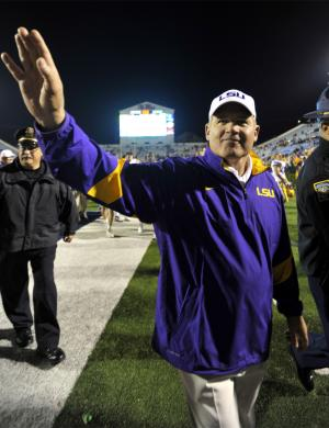 LSU coach Les Miles waves to fans at the end of an NCAA college football game against Mississippi in Oxford, Miss., Nov. 19, 2011. Top ranked LSU won 52-3. (AP Photo/Austin McAfee)