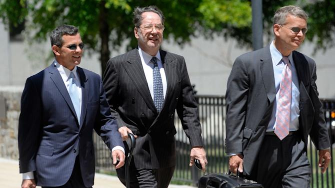 Presidential memorabilia collector Barry Landau, center, arrives at federal court for his sentencing hearing in Baltimore Wednesday, June 27, 2012. He pleaded guilty in February to stealing thousands of documents from historical societies and libraries nationwide. (AP Photo/Steve Ruark)
