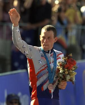 FILE - This Sept. 30, 2000, file photo shows U.S. cyclist Lance Armstrong waving after receiving the bronze medal in the men's individual time trials at the Summer Olympics in Sydney, Australia. His seven Tour de France titles erased from cycling's record books, Armstrong still holds claim to one piece of sports silverware: an Olympic medal. The fate of Armstrong's medal will be addressed when the International Olympic Committee executive board meets next week in Lausanne, Switzerland. (AP Photo/Ricardo Mazalan, File)