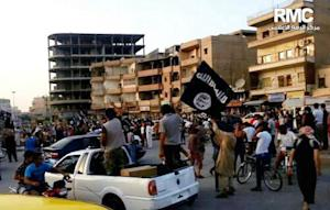 FILE - This undated file photo posted by the Raqqa…