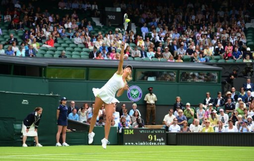 Russia's Maria Sharapova serves during her first round women's singles match against Australia's Anastasia Rodionova