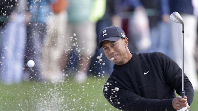 Tiger Woods hits out of a bunker on the fourth hole during the third round of the Honda Classic golf tournament, Saturday, March 2, 2013 in Palm Beach Gardens, Fla. (AP Photo/Wilfredo Lee)