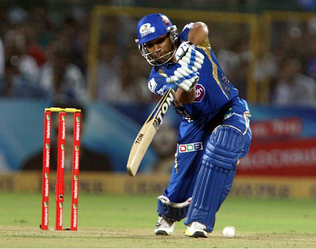 Mumbai Indians batsman Rohit Sharma in action during the CLT20 match against Rajasthan Royals at Sawai Mansingh Stadium, Jaipur on Sept. 21, 2013. (Photo: IANS)