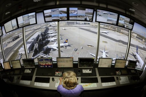 <p>This file photo shows a control tower operator monitoring air traffic from a control tower at Frankfurt International Airport, in 2010. The European Commission plans to sanction EU members to nudge them into action on efforts to create a pan-European airspace that would cut costs and delays, according to an EU source.</p>