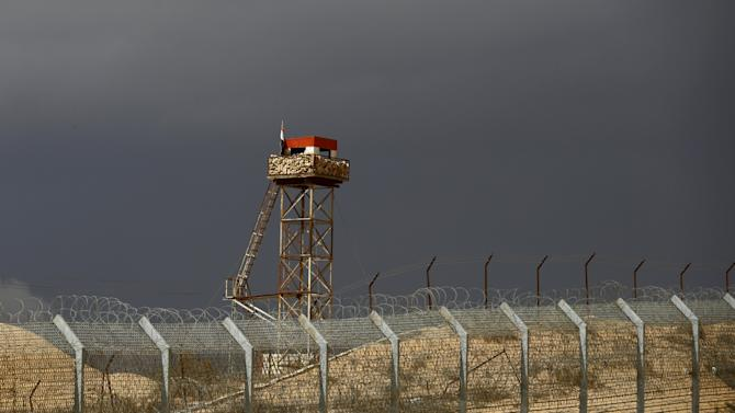 An Egyptian watch tower is seen from the Israeli side of the border fence with Egypt's Sinai peninsula, in Israel's Negev Desert