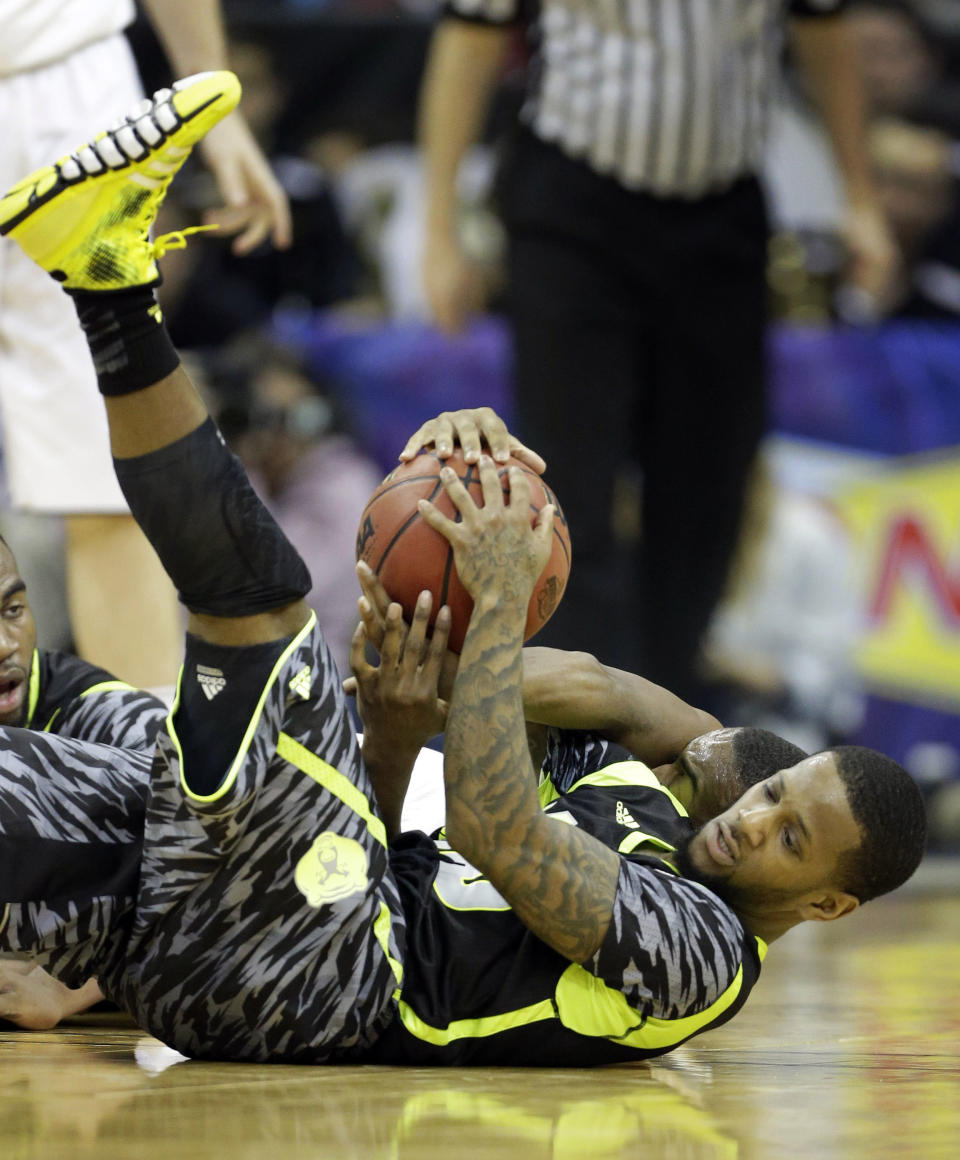 Baylor guard Pierre Jackson, foreground, and Oklahoma State guard Markel Brown go to the floor for a loose ball during the first half of an NCAA college basketball game in the Big 12 tournament on Thursday, March 14, 2013, in Kansas City, Mo. (AP Photo/Orlin Wagner)