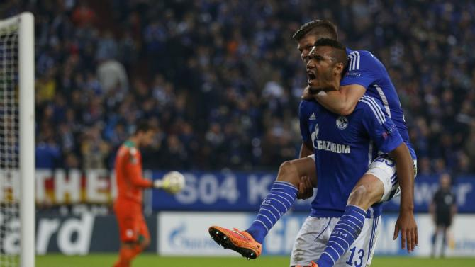 Schalke 04's Choupo-Moting and Huntelaar celebrate a goal against Sporting during their Champions League group G soccer match in Gelsenkirchen