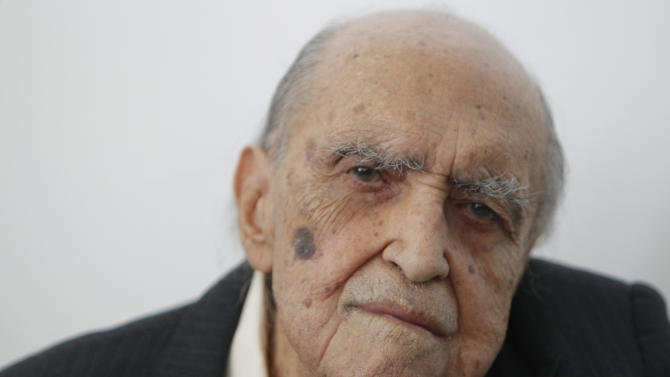 FILE - In this Sept. 10, 2010, Brazilian architect Oscar Niemeyer attends a ceremony where he was decorated with Spain's Arts and Letters medal in Rio de Janeiro, Brazil.  A spokeswoman for the Hospital Samaritano says the 104-year-old was admitted to the hospital in Rio de Janeiro on Tuesday, Nov. 6, 2012, but did not give a specific reason for his hospitalization.  Niemeyer designed much of Brazil's futuristic capital, Brasilia, and Rio's Sambadrome, where the annual carnival parade is held. He also helped design the United Nations building in New York City. (AP Photo/Felipe Dana, File)