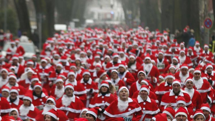 "Runners dressed as Father Christmas start in the so-called ""Nikolaus Run"" (Santa Claus Run) in the east German town of Michendorf"