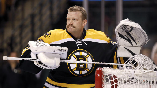 FILE - In this February 2012 file photo, Boston Bruins goalie Tim Thomas gets ready for an NHL hockey game between the Bruins and the Pittsburgh Penguins in Boston. Thomas, who has said he won't play this season, was traded by the Boston Bruins to the New York Islanders on Thursday, Feb. 7, 2013, for a conditional second-round draft choice either next year or in 2015. (AP Photo/Winslow Townson, File)
