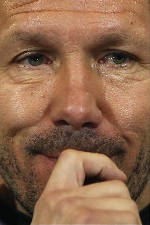 Atletico Madrid coach Diego Simeone, of Argentina, listens to question during a press conference ahead of Tuesday's Champions League, round of 16, second leg, soccer match against AC Milan, at the