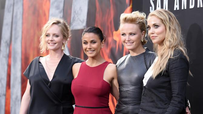 """Marley Shelton, from left, Emmanuelle Chriqui, Malin Akerman and Elizabeth Berkley arrive at the premiere of """"San Andreas"""" at the TCL Chinese Theatre on Tuesday, May 26, 2015, in Los Angeles. (Photo by Richard Shotwell/Invision/AP)"""