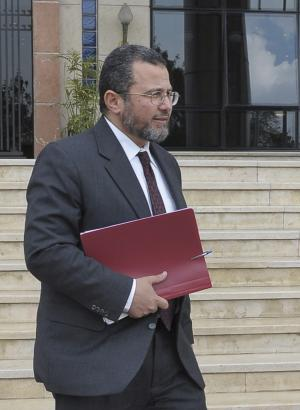 In this Thursday, March 29, 2012 photo, former Egyptian minister of water resources and irrigation in the outgoing, military-appointed government, Hesham Kandil leaves a meeting in Cairo, Egypt. On Tuesday, July 24, 2012, Egyptian President Mohammed Morsi, of the Muslim Brotherhood, named the young, U.S. -educated Kandil as the prime minister designate and tasked him with putting together a new administration, nearly a month after Morsi was sworn in as Egypt's first freely elected civilian president .