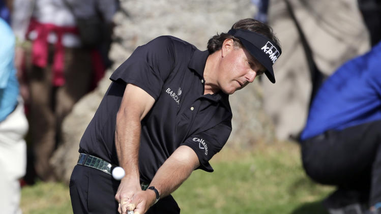 Phil MIckelson chips to the 10th green, overshooting and landing in a bunker, on his way to a triple bogey on the hole in the second round of the Northern Trust Open golf tournament at Riviera Country Club in the Pacific Palisades area of Los Angeles, Friday, Feb. 15, 2013. (AP Photo/Reed Saxon)