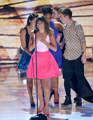 Lea Michele speaks on stage at the Teen Choice Awards at the Gibson Amphitheater on Sunday, Aug. 11, 2013, in Los Angeles. Pictured in background from left, Jenna Ushkowitz, Amber Riley and Kevin McHale. (Photo by John Shearer/Invision/AP)