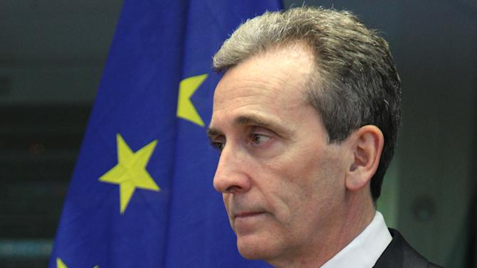 Italian Finance Minister Vittorio Grilli attends the Committee on Economic and Monetary Affairs, at the European Parliament building, in Brussels on Monday, Jan. 21, 2013. (AP Photo/Yves Logghe)