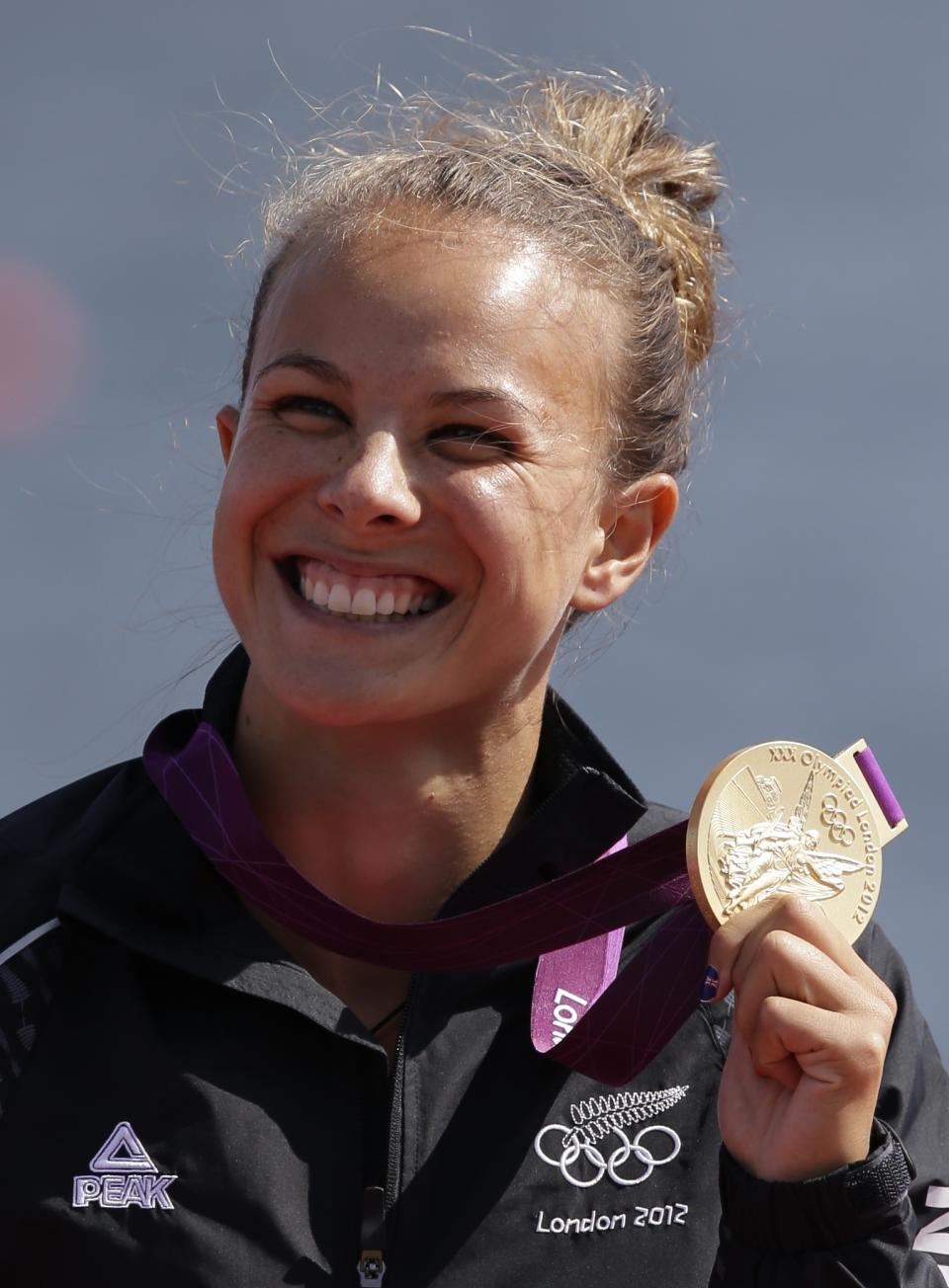 New Zealand's Lisa Carrington celebrates at the podium after winning the gold medal women's kayak single 200m in Eton Dorney, near Windsor, England, at the 2012 Summer Olympics, Saturday, Aug. 11, 2012. (AP Photo/Natacha Pisarenko)