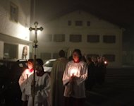 Believers celebrate a morning prayer in front of the house in which Pope Benedict XVI was born, in southern Germany, in 2010. Germany's Roman Catholics who refuse to pay a church tax will be barred from receiving the sacraments or becoming a godparent, under controversial new restrictions entering into force on Monday
