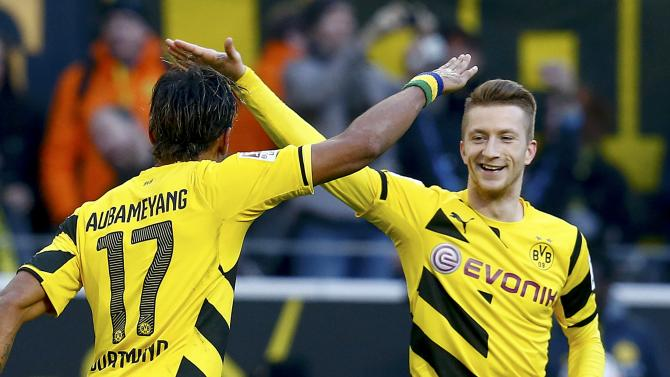 Borussia Dortmund's Aubameyang celebrates with Reus after scoring against Schalke 04's during Bundesliga soccer match in Dortmund