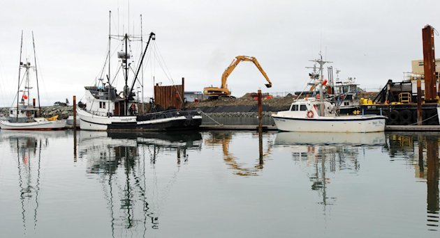 An Oct. 26, 2012 photo shows a large backhoe repairing damage caused by the March, 2011 tsunami at the boat basin in Crescent City, Calif. Once it overcomes some construction setbacks, the port hopes to have the West Coast's first harbor designed to withstand the kind of tsunami expected to hit every 50 years. (AP Photo/Jeff Barnard)