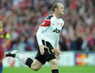 El delantero del Manchester United Wayne Rooney celebra un gol marcado al FC Barcelona en la final de la Liga de Campeones el 28 de mayo de 2011 en el estadio de Wembley, en Londres. (AFP/Archivo | Franck Fife)