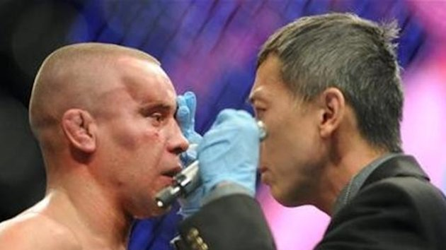 Mark Hominick, left, gets his eye checked